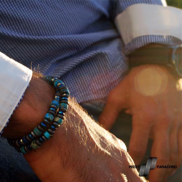 Dominion férfi ásvány karkötő: Szakítva a korábbi hagyományokkal a Dominion karkötőket nem gömbölyű ásványokból, hanem korong formájúakból készítjük. A fényes és matt elemek váltakozása és a dupla szálas megoldás igazán domináns megjelenést eredményez, rögtön oda vonzza a tekintetet. Ha nem csak egymagában viselnétek, kiváló választás lehet mellé a Lucent acél karperec kék változata, együtt remek párost alkotnak és garantáltan nem maradtok észrevétlenek egy ilyen összeállítással. Dupla szálas karkötő 6mm-es hematit és jáspis ásványok