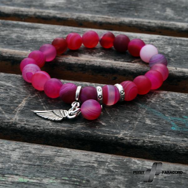 Wing Női ásvány karkötő: Egy igazi angyali karkötő. Rózsaszín és kék változatban elérhető. Egyszerű, mégis mutatós, hétköznapi viselethez ajánljuk, hogy a kiegészítő is dobjon a megjelenéseden! elasztikus magszál festett achát ásványok angyalszárny dekoráció